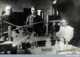 Marie and Pierre Curie (centre) in their laboratory, Paris, 1900, Wellcome Library